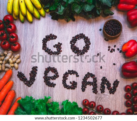 Go vegan concept green organic vegetables & bean on wood background. #1234502677