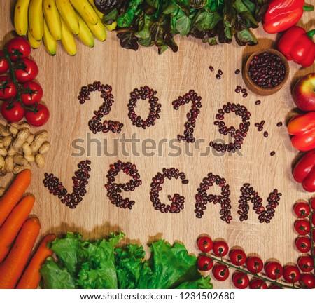 Go vegan concept green organic vegetables & bean on wood background. #1234502680