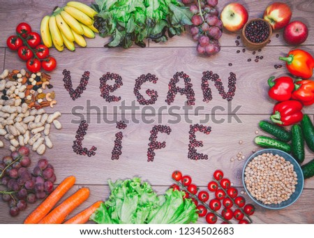 Go vegan concept green organic vegetables & bean on wood background. #1234502683