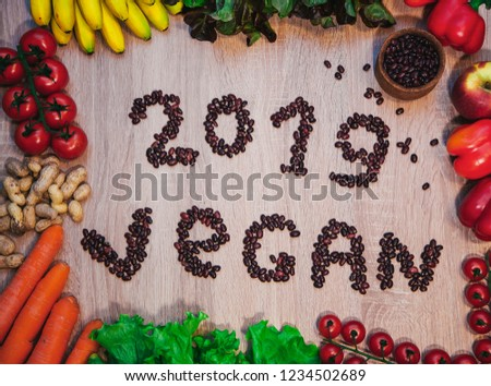 Go vegan concept green organic vegetables & bean on wood background. #1234502689