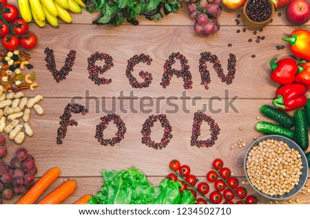 Go vegan concept green organic vegetables & bean on wood background. #1234502710