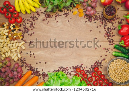 Go vegan concept green organic vegetables & bean on wood background. #1234502716