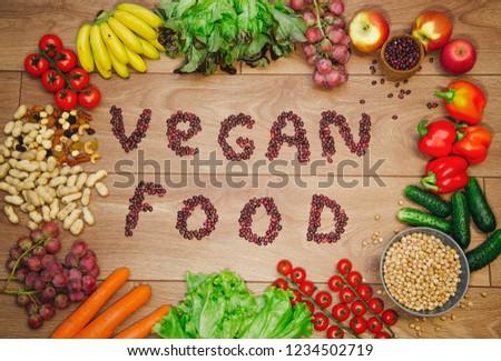 Go vegan concept green organic vegetables & bean on wood background. #1234502719