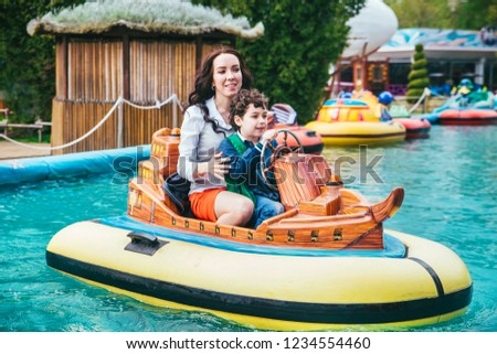Son and mother in the amusement park. #1234554460