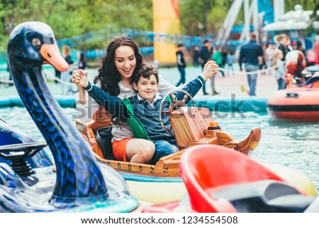 Son and mother in the amusement park. Royalty-Free Stock Photo #1234554508