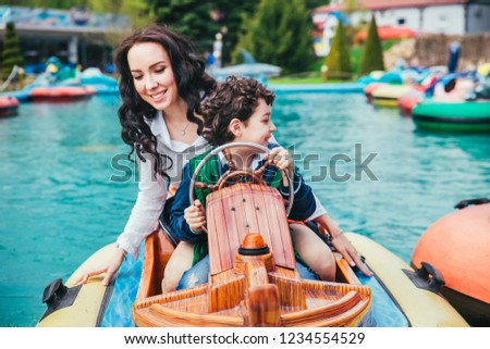 Son and mother in the amusement park. #1234554529
