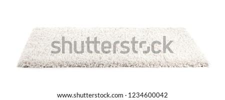Fuzzy carpet on white background. Interior element #1234600042