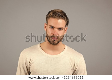 Man with unshaven face hair and fashionable haircut in white shirt pose on grey background. Fashion, barbershop, beauty salon concept. #1234653211
