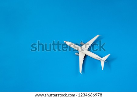 Picture of airplane isolated on empty blue background