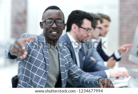 young businessman reaching out for a handshake #1234677994