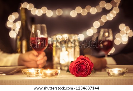 Man and woman enjoying a romantic candle light dinner together.   #1234687144