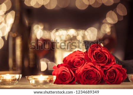 Bouquet of red roses in a romantic restaurant setting.   #1234689349