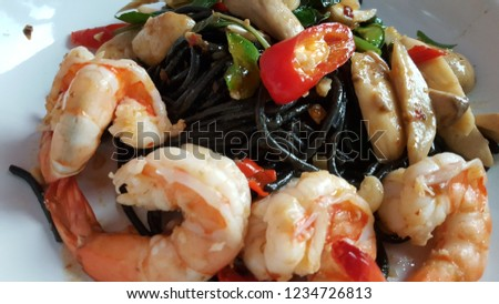 Spicy squid ink spaghetti with seafood. #1234726813