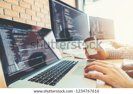 Developing programmer Team Development Website design and coding technologies working in software company office #1234767616