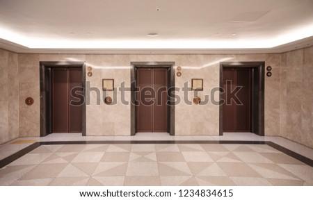 Three elevator doors in building #1234834615