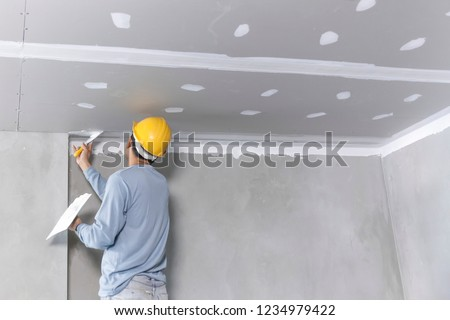 Craftsman working with plaster gypsum ceiling for interior build gypsum board ceiling #1234979422