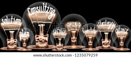 Photo of light bulbs with shining fibers in a shape of CONSULTING concept related words isolated on black background Royalty-Free Stock Photo #1235079259