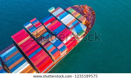 Aerial view container cargo ship, business freight shipping international by container cargo ship in the open sea. #1235189575