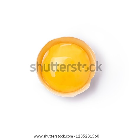 Broken egg cut out. Top view. Royalty-Free Stock Photo #1235231560