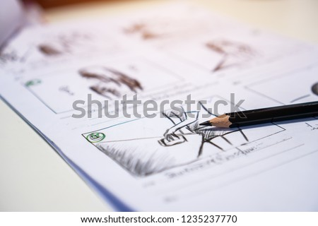 Pencil on Storyboard movie video layout for pre-production, storytelling drawing creative for process production media films. Script editors and writing graphic in form displayed in maker shooting