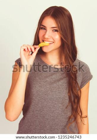 beautiful teen girl eating potato chips isolated on white model Caucasian