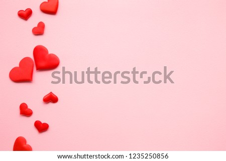 Bright red textile hearts on pastel pink background. Love concept. Top view. Mockup for positive idea. Empty place for lovely, emotional, sentimental text, quote or sayings. #1235250856