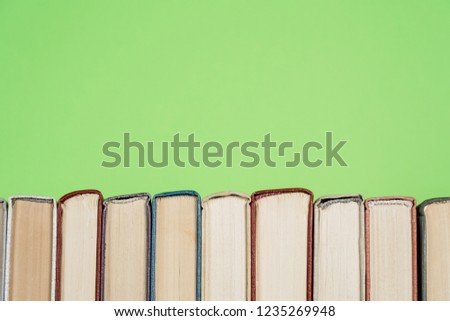 Many Books Piles. Hardback books on wooden table. Back to school. Copy space #1235269948