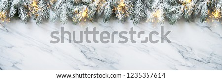 Christmas background with xmas tree on white marble background. Merry christmas greeting card, frame, banner. Winter holiday theme. Happy New Year. Space for text. Flat lay #1235357614