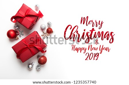 Merry Christmas and Happy Holidays greeting card, frame, banner. New Year. Christmas red gifts, presents on white background top view. Winter holiday xmas theme. Noel. Flat lay. Royalty-Free Stock Photo #1235357740