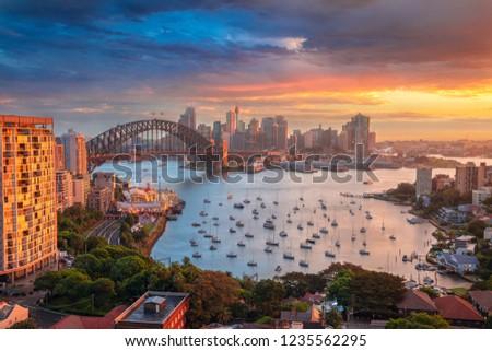 Sydney. Cityscape image of Sydney, Australia with Harbour Bridge and Sydney skyline during sunset. #1235562295