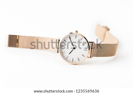 Luxury watch isolated on white background. With clipping path. Gold watch. Women watch. Female watch. #1235569636