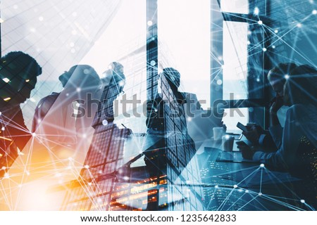 Silhouette of business people work together in office. Concept of teamwork and partnership. double exposure with network effects #1235642833
