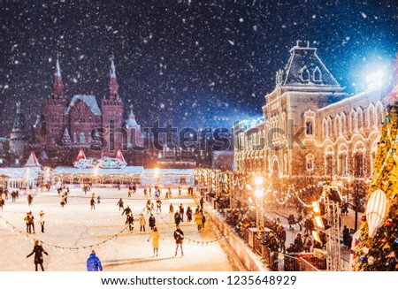 Moscow, Russia New Year.  Saint Basil's Cathedral on the background.  Christmas holidays, snowy winter night landscape. Christmas fair on Festively decorated Red Square in snow. Christmas Market.   #1235648929