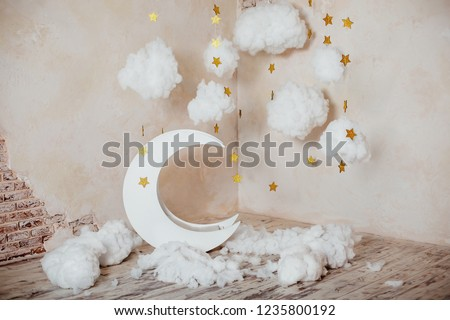 Children's location for a photo shoot. Moon with stars and clouds. Dreamy decor. Elements of the interior.