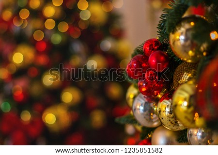Christmas balls and ribbon on the background of the Christmas tree #1235851582