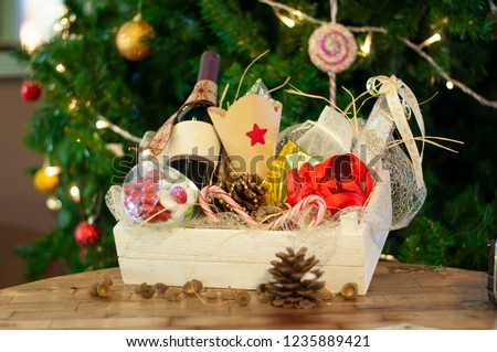 Christmas and New year gifts and baskets with sweets, alcohol, chocolate and cookies #1235889421