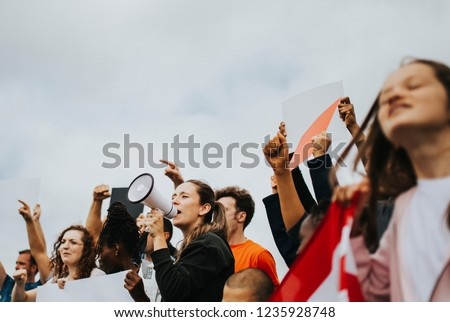 Group of American activists is protesting Royalty-Free Stock Photo #1235928748