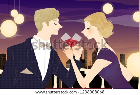 Man and woman toasting with glasses of red wine at dining table