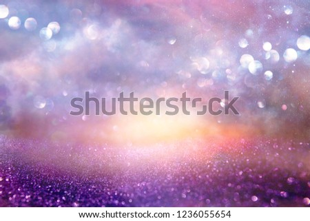 glitter vintage lights background. silver, purple and gold. de-focused. #1236055654