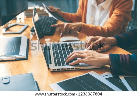 Professional Development programmer cooperating meeting and brainstorming and programming website working in a software and coding technology, writing codes and data code. #1236067804