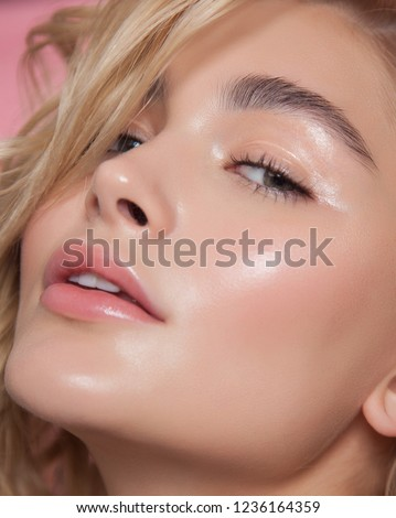 close-up beauty portrait. young model with glowing healthy skin. beautiful blonde woman with natural make-up #1236164359