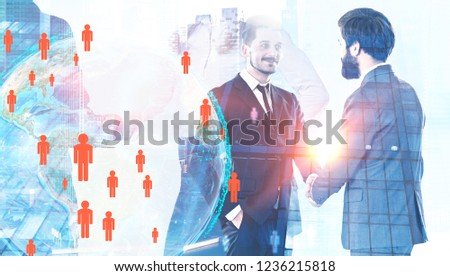 Two businessmen shaking hands standing over cityscape background with Earth hologram and people figures. Hr concept. Toned image double exposure Elements of this image furnished by NASA #1236215818