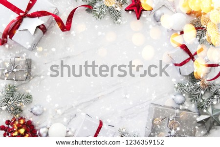 Merry Christmas and Happy Holidays greeting card, frame, banner. New Year. Red, silver Christmas gifts, presents and ornaments on white marble background top view. Winter holiday xmas theme. Noel. Fla #1236359152