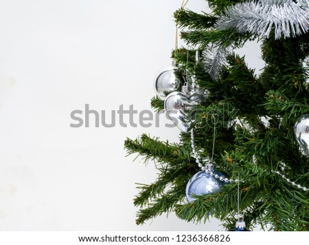 Silver Christmas decorations on a spruce branch on a white background #1236366826