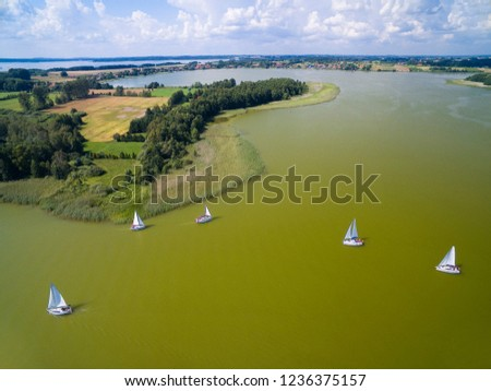 Aerial view of yachts sailing on Swiecajty Lake, Mazury, Poland #1236375157