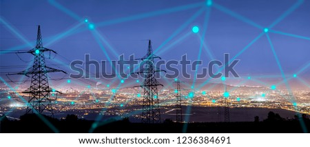 High power electricity poles in urban area connected to smart grid. Energy supply, distribution of energy, transmitting energy, energy transmission, high voltage supply concept photo.  #1236384691