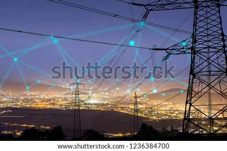High power electricity poles in urban area connected to smart grid. Energy supply, distribution of energy, transmitting energy, energy transmission, high voltage supply concept photo.  #1236384700