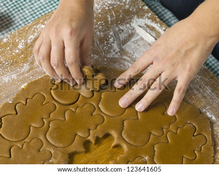 Human hand preparing gingerbread cookies at Christmas eve #123641605