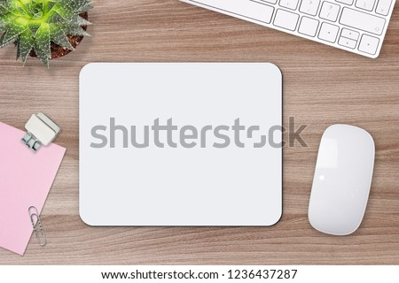 Mouse pad mockup. White mat on the table with props. #1236437287