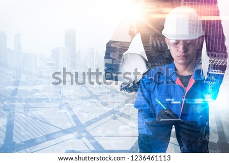 The double exposure image of the engineer standing during sunrise overlay with cityscape image. The concept of engineering, construction, city life and future. #1236461113